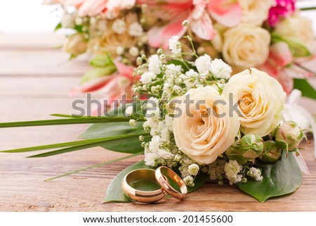Flowering branch with white delicate flowers on wooden surface. Declaration of love, spring. Wedding card, Valentine's Day greeting. Wedding bouquet, background. Empty wooden tabletop Space for text  - stock photo