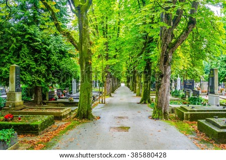 Flowers and candles on tomb stones at the Mirogoj cemetery. - stock photo