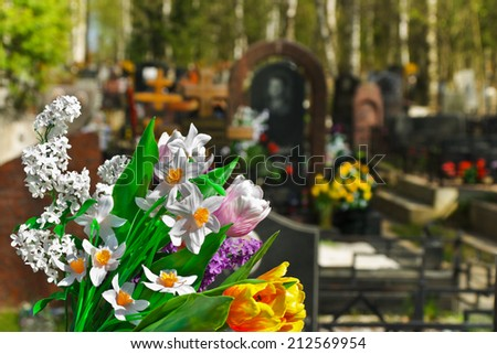 Flowers and cemetery on background - stock photo