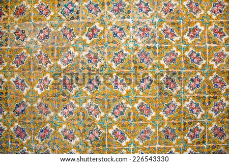 Flowers and colorful patterns on ceramic tiles in the traditional Persian style on the wall of the old royal palace in Tehran, Iran - stock photo