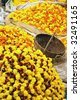 Flowers and garlands for sale at the flower market in Calcutta, India - stock photo