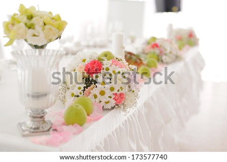 flowers and green apples on festive table