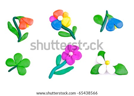 flowers and leaf made from plasticine - stock photo