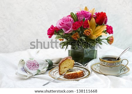 Flowers and morning coffee and cake (Ideal Mother's Day Image or any luncheon or breakfast) - stock photo