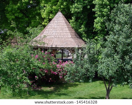 flowers and plants on gazebo in park - stock photo