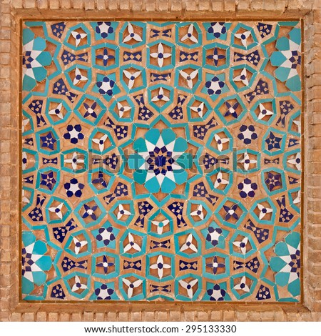 Flowers and stars motif design in Islamic Iranian pattern made of tiles and bricks in old Jame mosque of Yazd, Iran. - stock photo