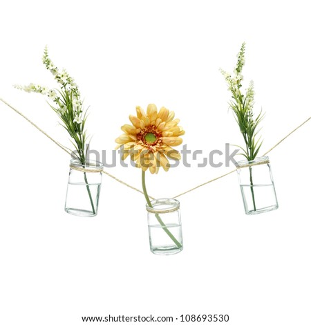 Flowers and vases hanging on a string