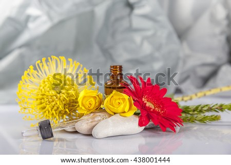 Flowers and zen stones on the grey background - stock photo
