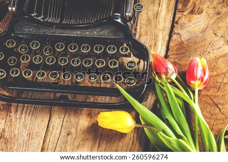 Flowers at the typewriter, writing a romantic letter. - stock photo
