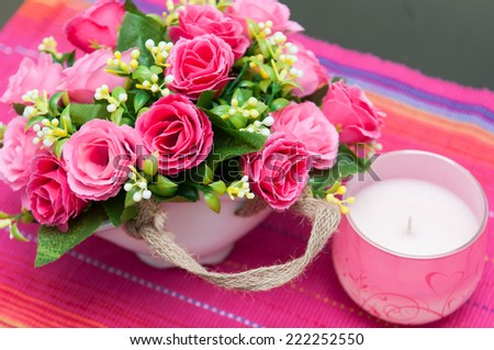 flowers basket. Festive table setting with basket of flowers and candle - stock photo