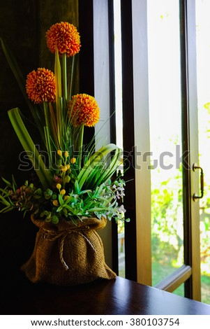 Flowers beside window