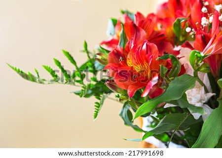 flowers bouquet red alstroemeria arrange for decoration in home, selective focus - stock photo