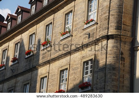 Flowers decorate a stone baroque building in  Bamberg, Germany