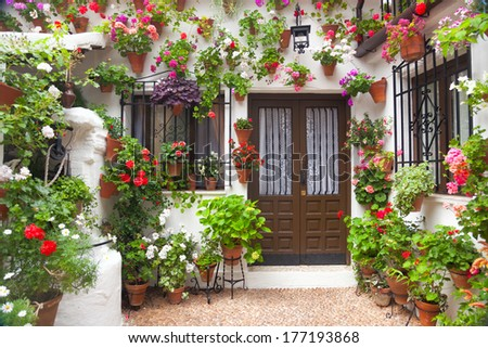Flowers Decoration of Vintage Courtyard, typical house in Cordoba - Spain, European travel - stock photo
