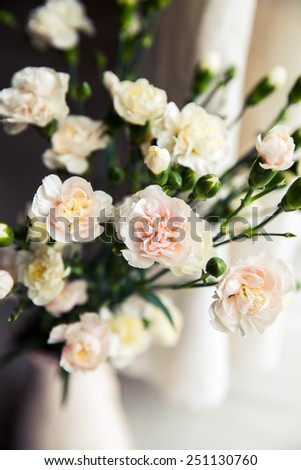 flowers. delicate bouquet of carnations in a vase vintage. romance - stock photo