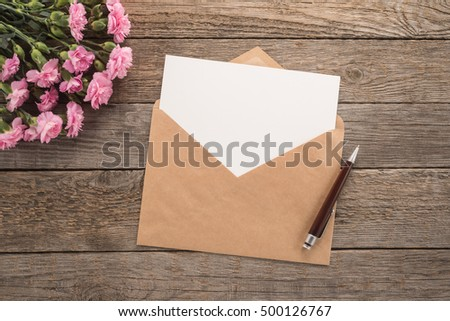 Flowers, envelope and pen on a table