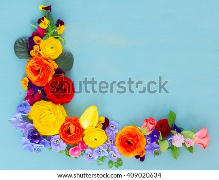 Flowers festive composition, flowers frame on blue wooden table with copy space, fresh cut flowers - stock photo