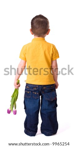Flowers for mammy. Small boy waiting to present tulip bouquet. Isolated on white