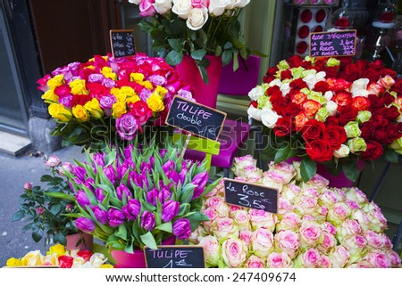 Flowers for sell at open air flower market. Dutch tulips and roses.