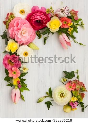 Flowers frame on white wooden background. Top view with copy space - stock photo