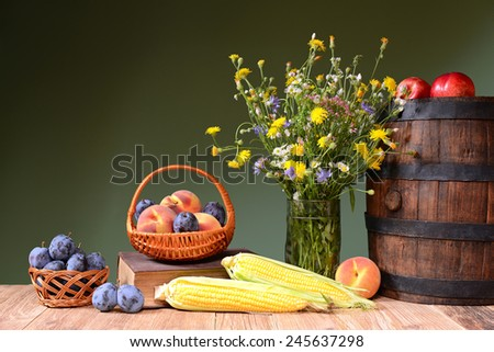 Flowers from the garden, fruit and wooden barrel - stock photo