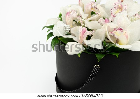 Flowers in a decorative box - stock photo
