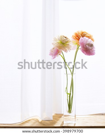 Flowers in a vase interior - stock photo