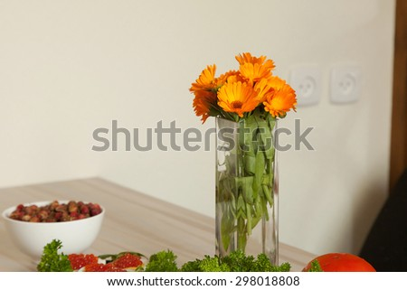 flowers in a vase on the table - stock photo