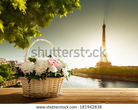 flowers in basket and Eiffel tower, Paris - stock photo