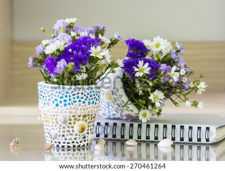 Flowers in mosaic flower pot decorated living room - stock photo
