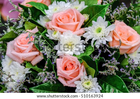 Flowers in pastel styles.Background of Beautiful Big bunch bouquet of red roses flower decoration.selective focus.