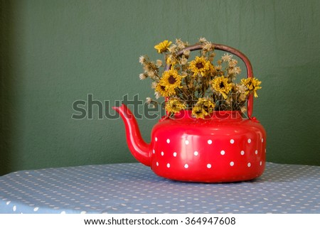 flowers in teapot on wooden table  background, Still life style