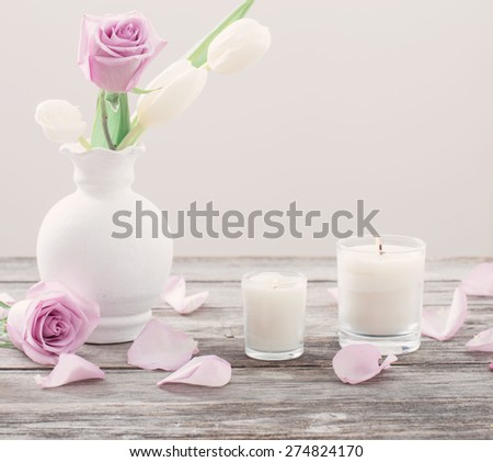 flowers in vase with scented candle - stock photo