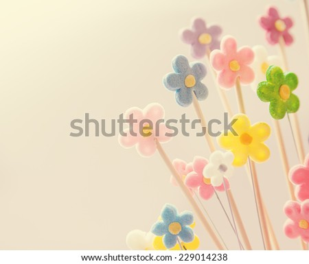 Flowers made of sugar as decoration for birthday cake.  - stock photo