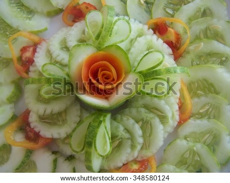 Flowers of cucumbers and tomatoes - stock photo