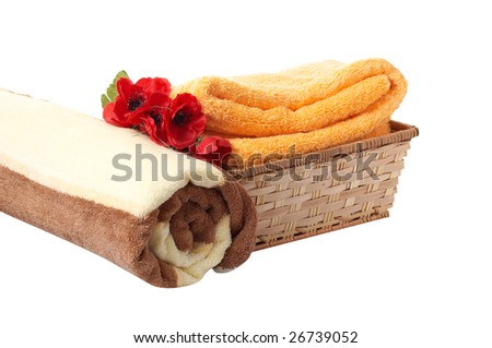 Flowers of poppy ,towels and basket isolated on a white background.