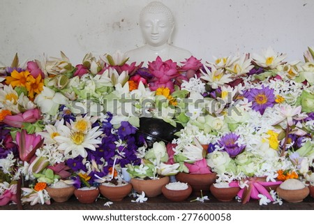 Flowers offering for a statue of Buddha
