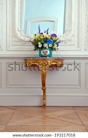 Flowers on a baroque console table