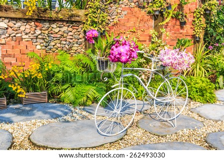 Flowers on a bicycle - stock photo