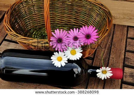 flowers on basket and bottle of wine