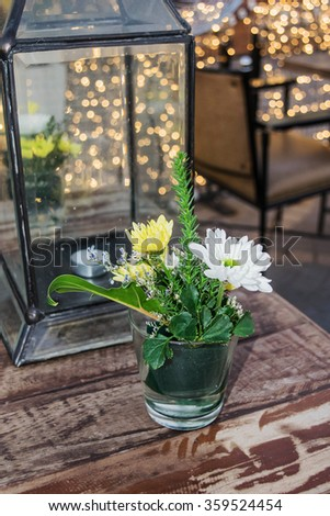 Flowers on table in restaurant.