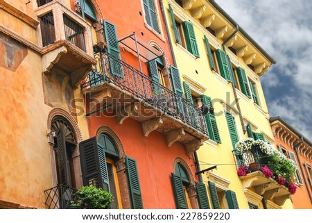 Flowers on the balcony of the beautiful Italian home - stock photo