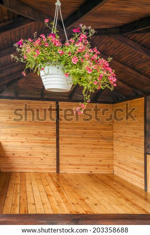 flowers on the window alcoves, on wood background - stock photo