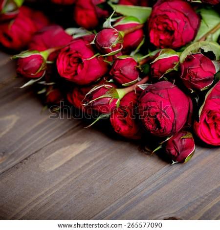 Flowers on vintage wood background - stock photo