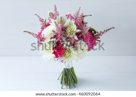 Flowers on white wood background