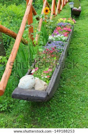 Flowers planted in a long wooden box
