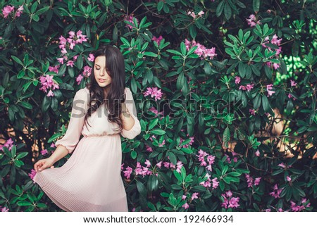 Flowers portrait.Sexy woman with flowers.Portrait of a romantic smiling young woman with flowers outdoors. - stock photo