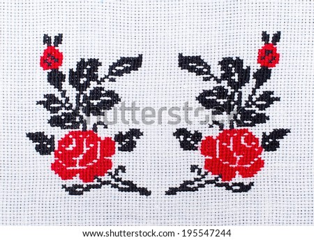 flowers roses embroidered cross-stitch pattern, ethnic ornament - stock photo