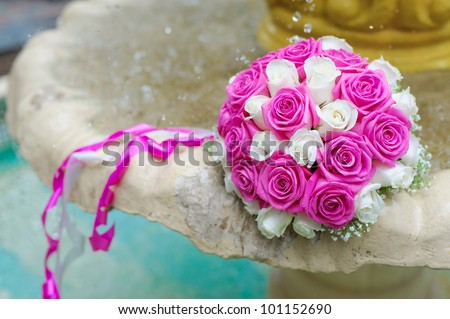 flowers roses wedding bouquet fountain sprays water droplets - stock photo
