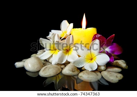 Flowers candle white rock spa use stock photo royalty free flowers with candle white rock for spa use isolated on black mightylinksfo Gallery